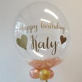 Lovedeco - Bubble ballon met eigen tekst gevuld met veren, happy birthday Katy rosé goud en goud