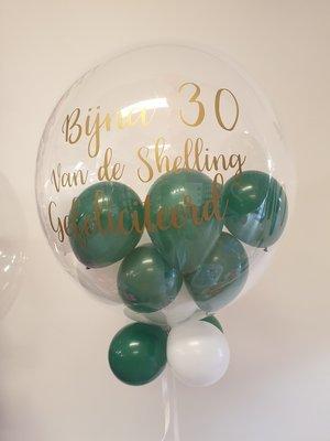 Gepersonaliseerde bubble ballon met ballonnetjes